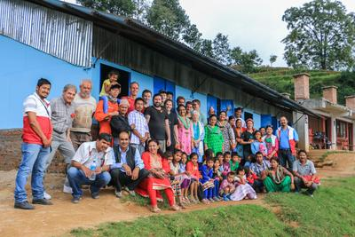 Building volunteers, Projects broad staff, staff and students from Shree Phulchoki Primary School, and members of the Nepal Youth foundation outside the newly built classrooms in Nepal