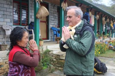 Peter Slowe greets a local woman in Nepal