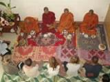 Volunteers and monks at ceremony