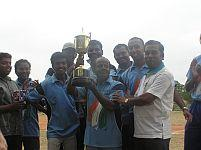 The winning team with the trophy