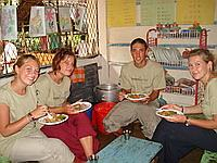 Volunteers Trying the Curry Too