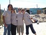 South Africa Volunteers Help Housing Charity