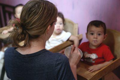 SUNY Cortland students helps with meal time in a local Care Center in Costa Rica