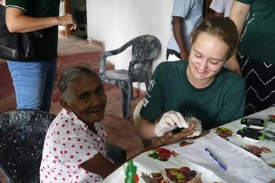 Projects Abroad Medicine volunteers test blood sugar and blood pressure at medical outreach camp in rural Colombo