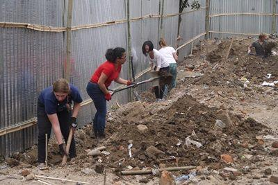 Projects Abroad Disaster Relief volunteers lay foundation for a new classroom at a Nepalese school in Kathmandu, Nepal