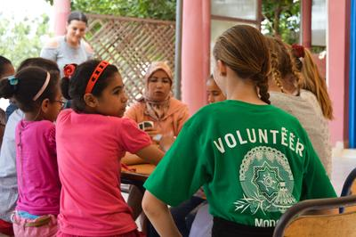 Volunteer with children abroad on a Care Project