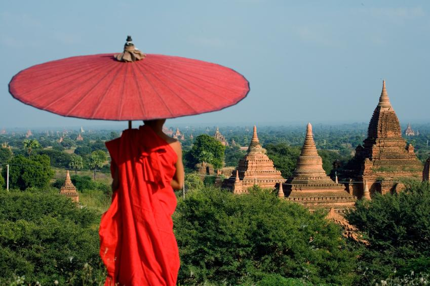 A beautiful scene of a Buddhist monk overlooking temples in Myanmar, Southeast Asia