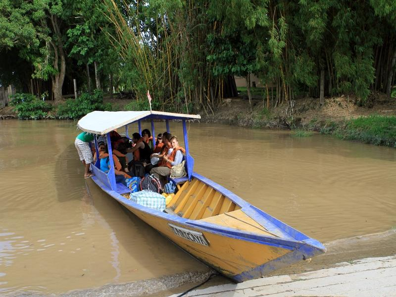 Volunteers aboard a boat setting of through the Taricaya reserve