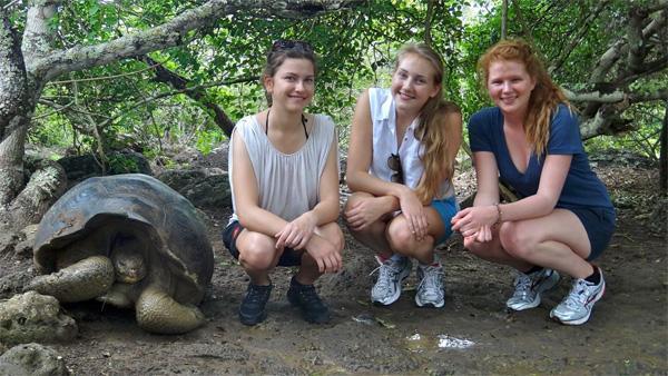 Volunteers with giant tortoise