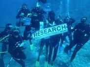 Volunteers scuba diving in Fiji