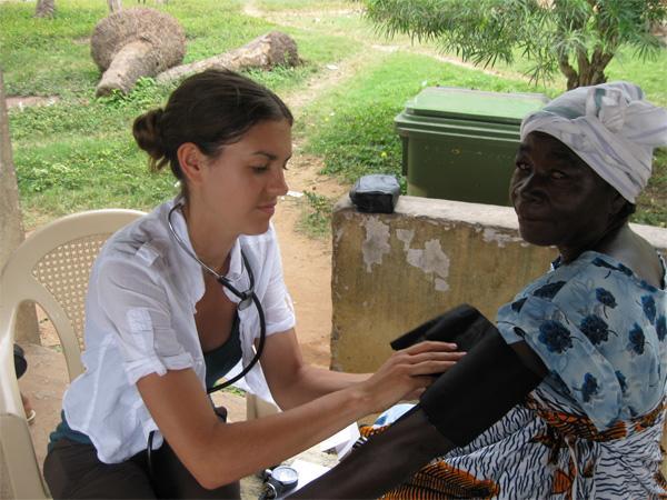Volunteer taking blood pressure