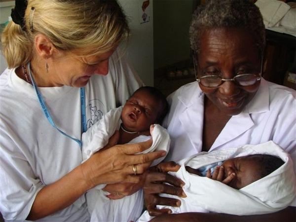 Volunteer with newborn