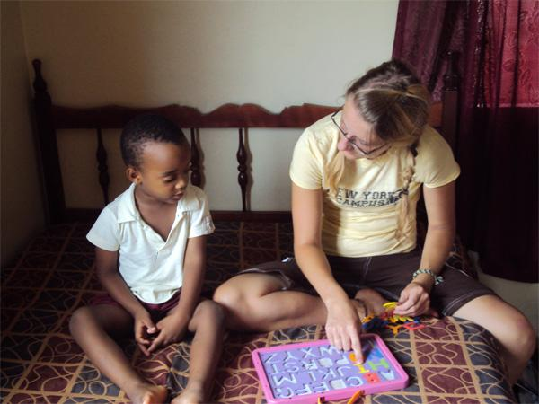 Care volunteer with young child