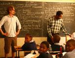 Volunteer assisting a teacher in Tanzania