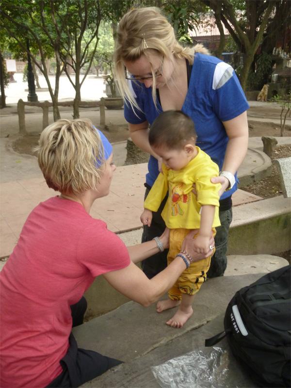 Volunteer with child
