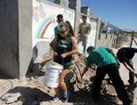 A group of volunteers at work at the Building project in Lavender Hill, Cape Town
