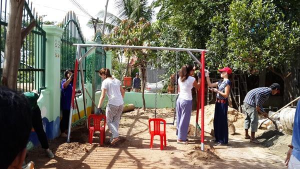 High-school volunteers buidling a swing