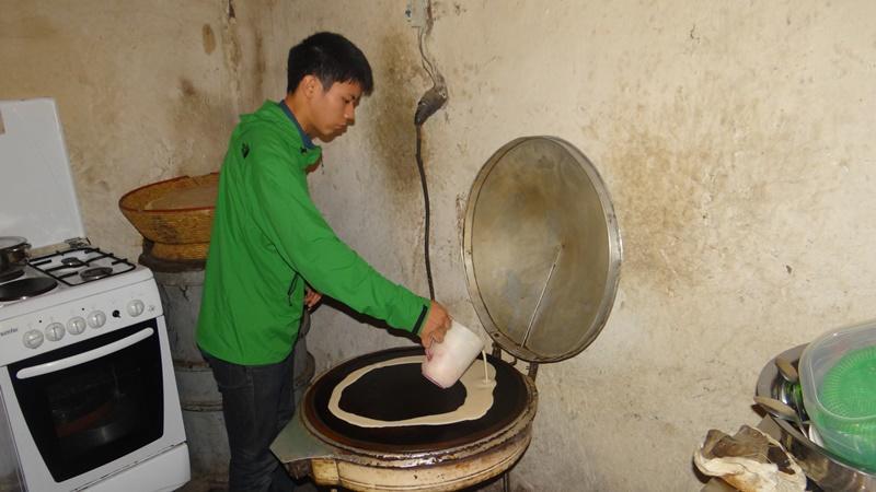 Volunteer busy making coffee in Ethiopia, Africa