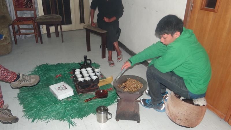 Volunteer making coffee in Ethiopia, Africa