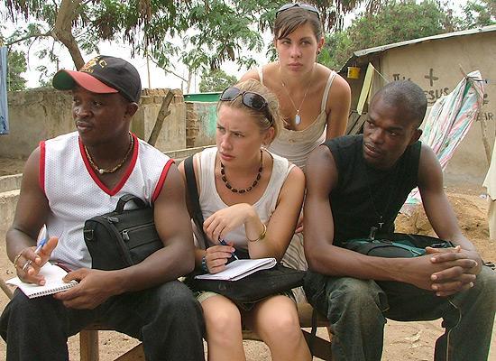 Volunteers with newspaper reporters
