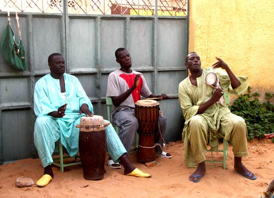 Locals playing on drums