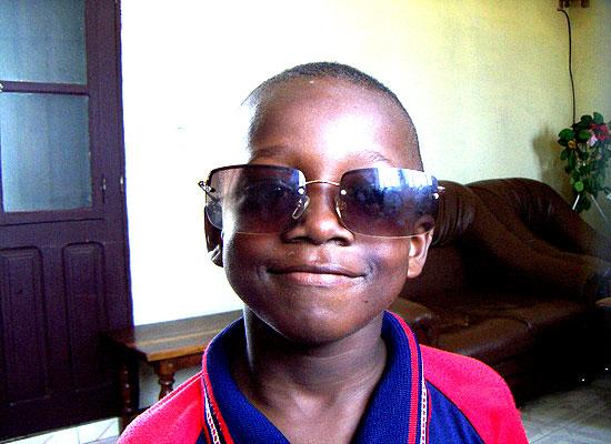 Orphanage kid with glasses