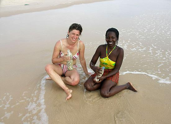 Volunteer and local on beach