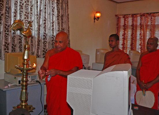 Buddhist monk lighting