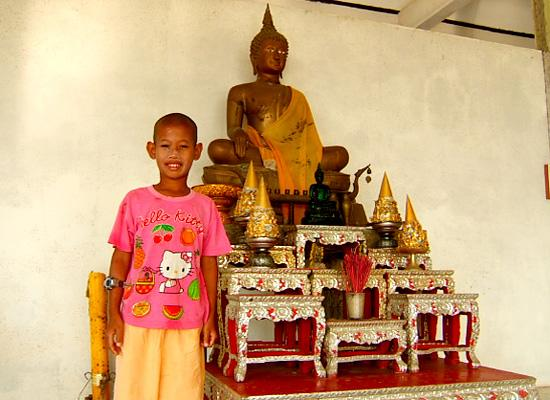 Kid Near Budha Statue