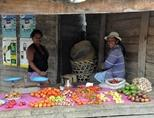 Two women selling fruit at a market in Madagascar