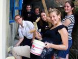 Volunteers painting a school