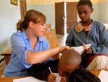 Volunteer giving English lessons