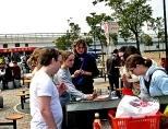 Volunteers eating in park
