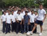 Volunteer coaching a soccer