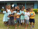 Teaching Volunteer giving certificates