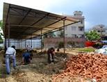Volunteers dig foundations for school