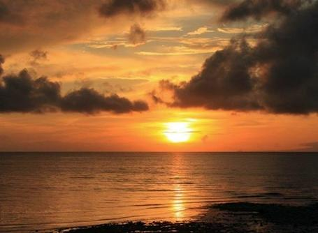 A scenic photograph of a sunset in the Philippines