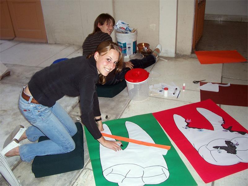 Volunteers creating dental health materials
