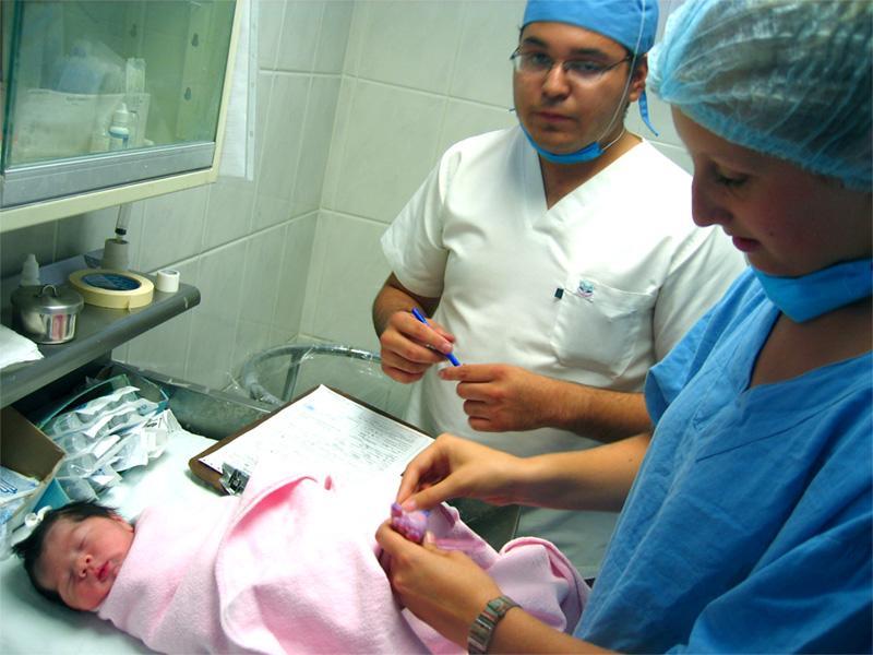 Medical intern with a newborn