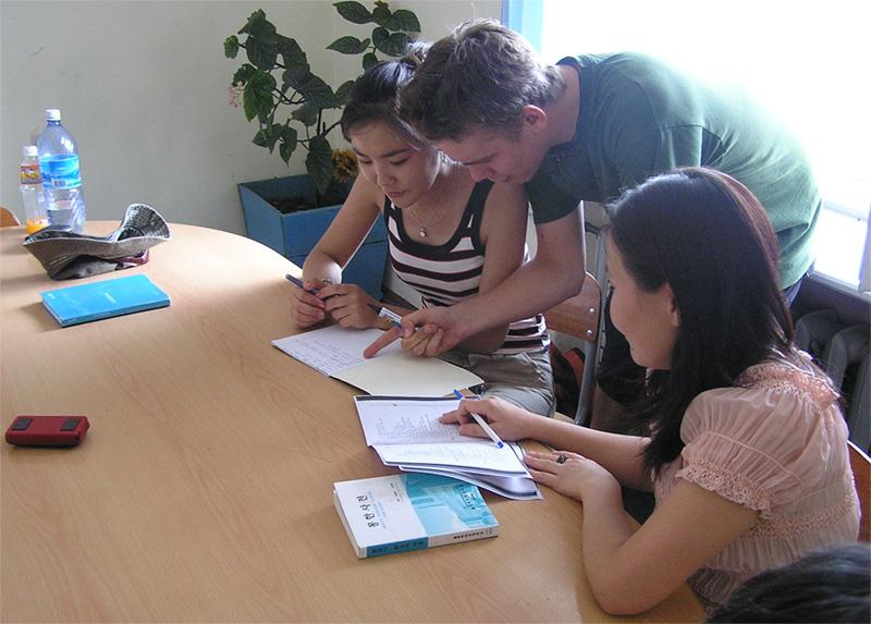 Volunteer helping a group of students