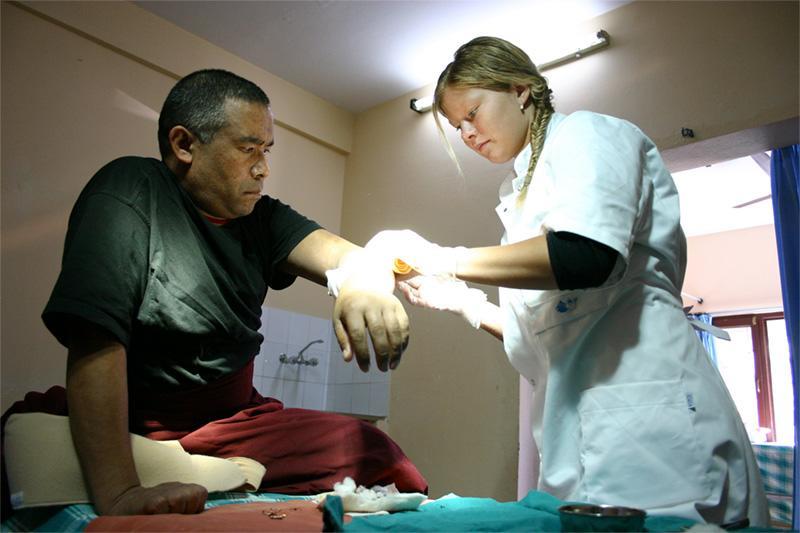 Medical intern helping