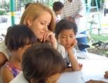 Volunteer with children in a teaching project in Philippines