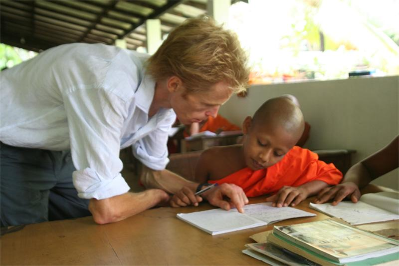 Volunteer teaching with monks