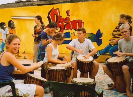 Volunteer during drumming lessons