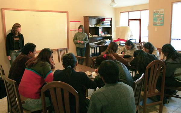 Volunteers teaching students in Bolivia