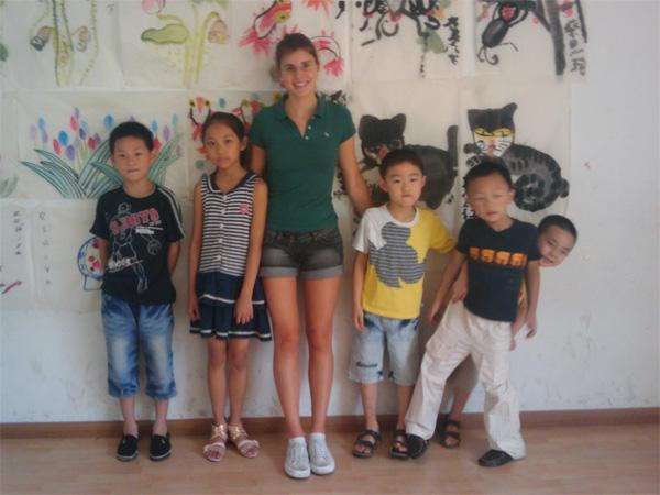 Care volunteer with children