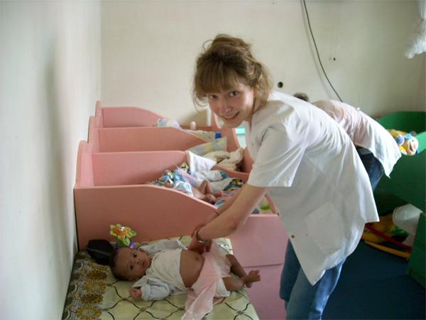 Care volunteer in nursery