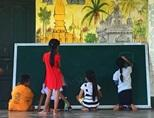 Schoolchildren drawing during a teaching project in Laos