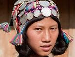 A teenage girl dressed in traditional clothes in Laos