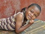 A local boy smiles at the camera in Madagascar